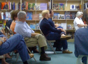 Bill listens to his brother Reynolds read from his new book